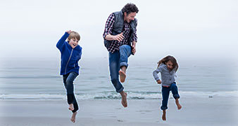 Young family jumping